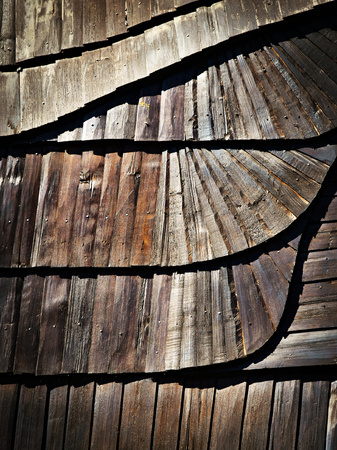 abstract background or texture Detail of wooden shingle roof with a tilde Stock Photo