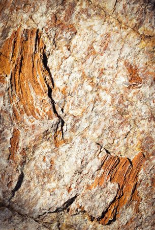 abstract background detail mica rocks of ocher and orange color Stock Photo
