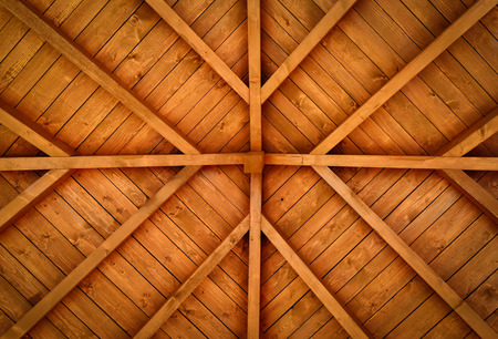 background or texture of a wooden cross with beams of the roof