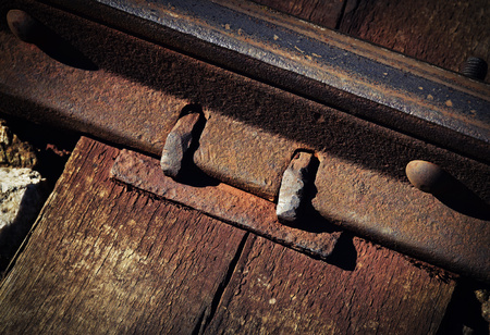 background Detail of an old rusty rail joint Stock Photo