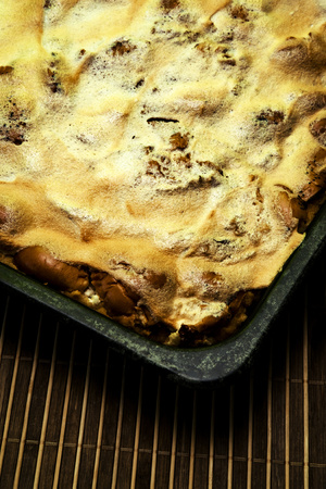 food background Apple pie on the baking pan