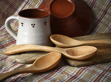 background still life from old dishes and wooden spoon