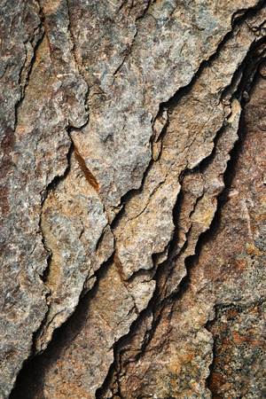 abstract background or texture with cracks eroded brownish rock