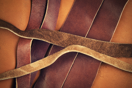 abstract background cut brown leather straps