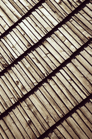 abstract background or texture with obliquely laid wooden shingle