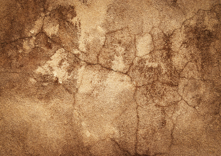 abstract background or texture old ocher plaster with cracks