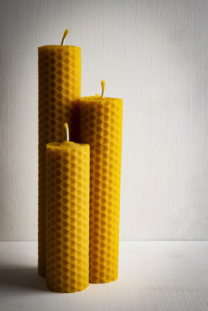 background Still life three retro beeswax candles
