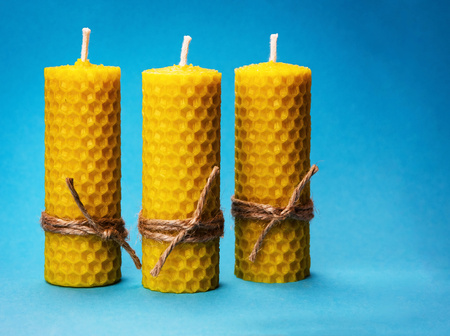 background three candles of yellow beeswax