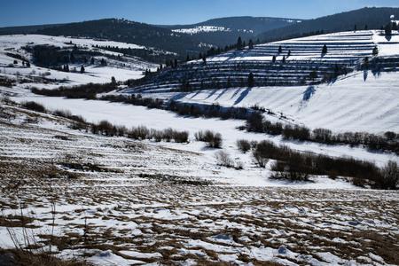 seasonal nature background hilly winter landscape