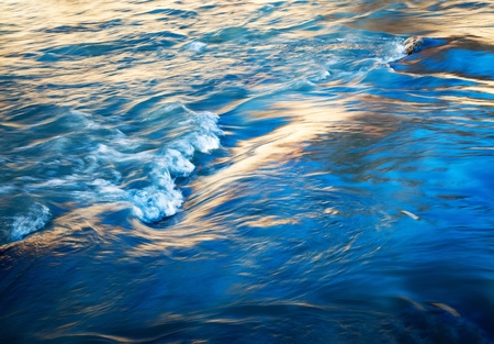 abstract nature background detail of the early evening dark river