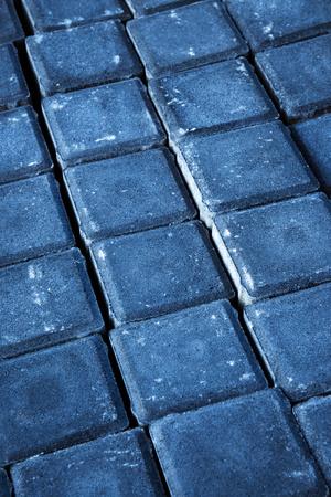 background or texture scuffed gray concrete cobblestones