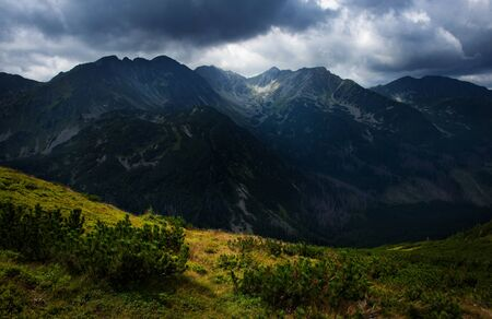nature landscape background Dark clouds on a mountain ridge