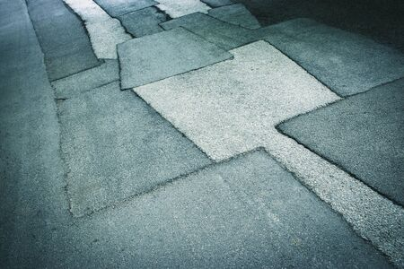 abstract background or texture asphalt road with patches 免版税图像