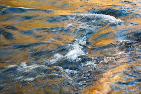 nature seasonal background Abstract color of autumn river Imagens