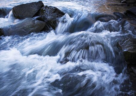 nature background detail of wild river with stones