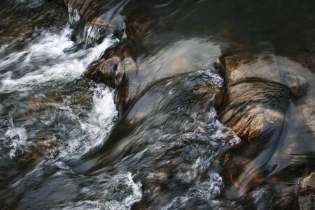 nature seasonal background Detail of fast flowing dark river 写真素材