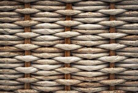background or texture Detail of a braided basket with paper tubes