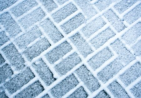 seasonal background or texture snow covered rectangular paving 写真素材