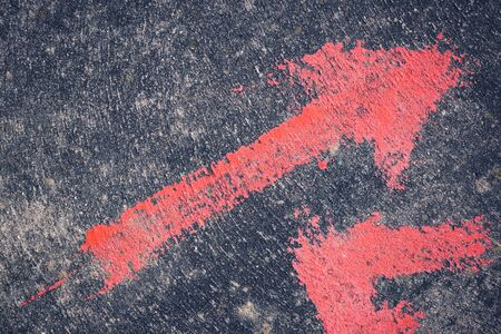 background or texture red direction arrow on gray concrete