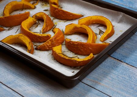background roasted pumpkin hokkaido on roasting pan