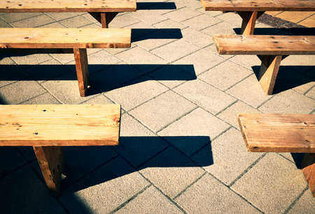 wooden seating benches laid on the tiles