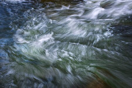 abstract background blurred view of a wild river