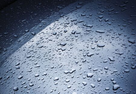 background or texture raindrops on a metallic paint sheet 写真素材