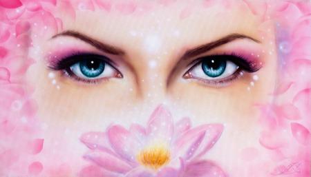 enchantress: A pair of beautiful blue women eyes beaming  up enchanting from behind a bloming rosa lotus flower
