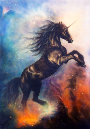 horses in the wild: painting on canvas of a black unicorn dancing in space