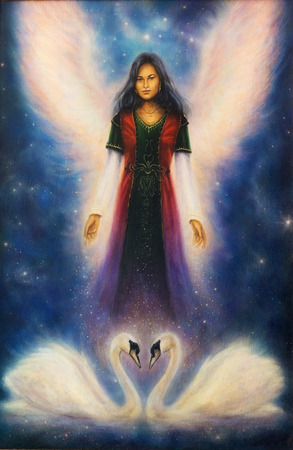 priestess: A beautiful oil painting on canvas of an angel woman with radiant wings above a pair of swans, on a starlight space background Stock Photo