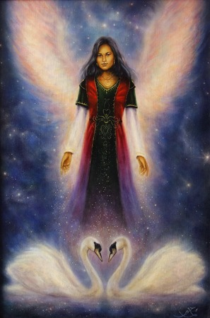 magical fairy: A beautiful oil painting on canvas of an angel woman with radiant wings above a pair of swans Stock Photo