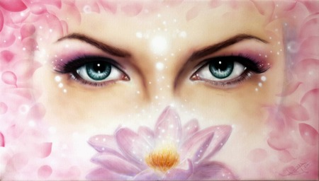 A pair of beautiful blue women eyes beaming  up enchanting from behind a bloming rosa lotus flower