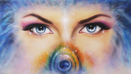 A pair of beautiful blue women eyes looking up mysteriously from behind a small rainbow colored peacock feather Stock Photo