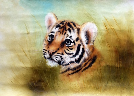 agressive: A beautiful airbrush painting of an adorable baby tiger head looking out from a green grass surroundings Stock Photo
