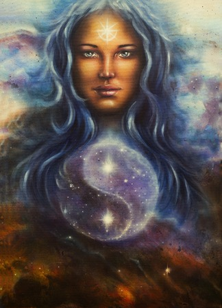 wholeness: beautiful painting on canvas of a space woman goddess Lada as a mighty loving guardian, with symbol jin jang Stock Photo