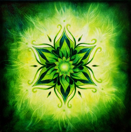 Flower Mandala on a green background color Imagens
