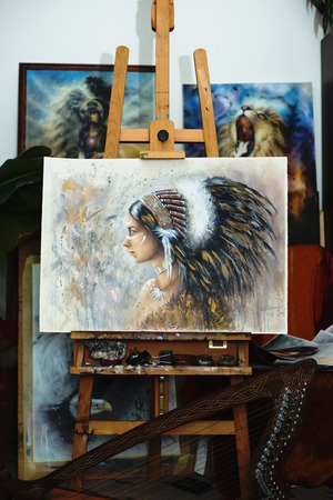 atelier: beautiful airbrush painting of a young native indian woman in painting atelier Stock Photo