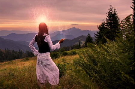 angel alone: Mystic woman in ancient dress alone in a beautiful romantic sunset landscape
