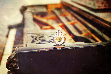 Vintage piano keys with antique pocket watch – time concept. vintage picture. photo