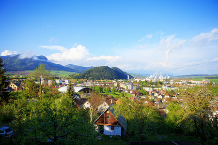 mnich: industrial refinery plant in a natural environment and mountain a town, View of a factory in the landscape