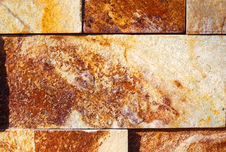 stonemason: Rock Wall Texture. Ocher background