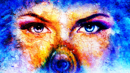 enchantress: pair of beautiful blue women eyes looking up mysteriously from behind a small rainbow colored peacock feather, texture collage with cracklee structure Stock Photo