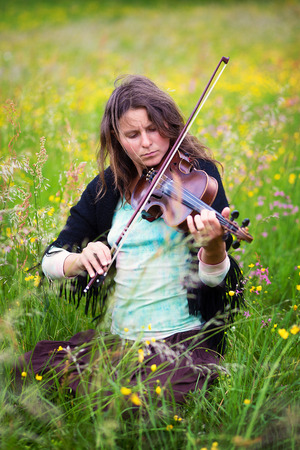 violinist: violinist on a meadow full of flowers.