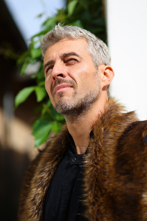 animal eye: Portrait of a sexy man in wolf  fur Stock Photo