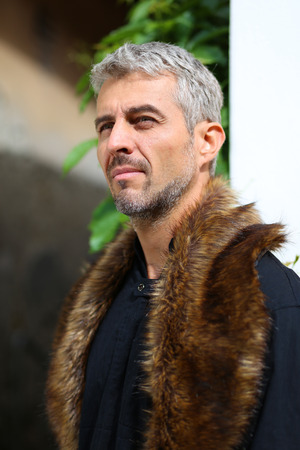 animal eye: Portrait of a sexy man in wolf  fur, Looking out into the distance