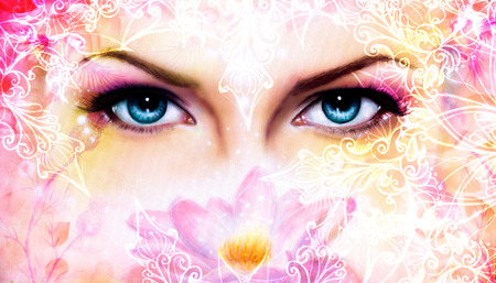 spiritual: blue women eyes beaming up enchanting from behind a blooming rose lotus flower, with ornaments Stock Photo