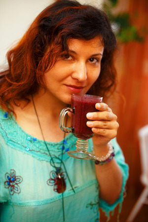 appreciating: Beautiful Young Woman with Fruit smoothie.