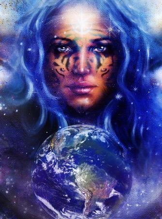 powerful aura: Goddess Woman with tattoo on face in space with light stars and Earth. Stock Photo