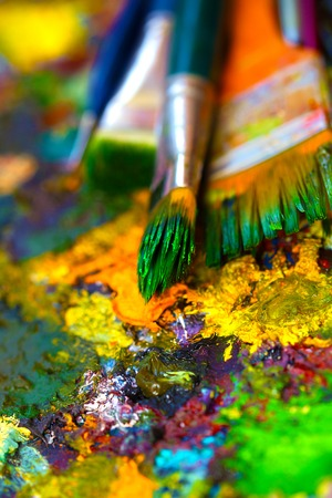 Paint brushes to the painting palette with colors.
