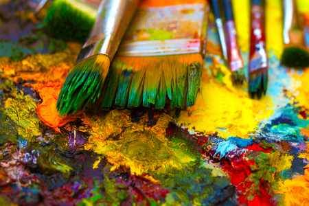buttercup  decorative: Paint brushes to the painting palette with colors.